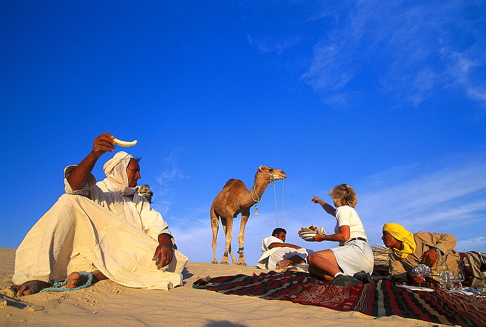 Picnic in the desert with Ben Ali, Dune landscape near Nefta, Tunesia