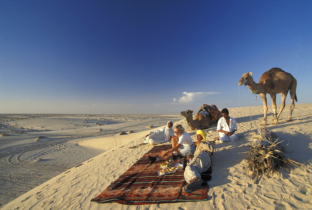 Picnic in the desert with local people, Dunes near Nefta, Tunesia