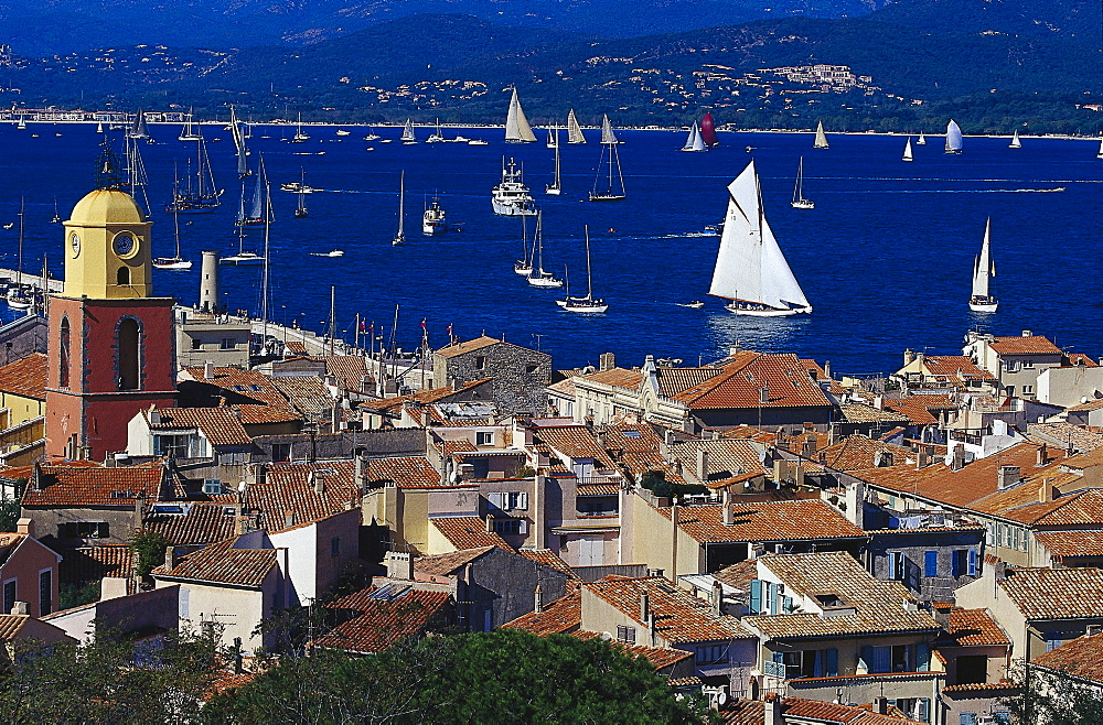Sunlit roofs and sailing boats at Golfe de St.Tropez, St. Tropez, Cote d¥Azur, Provence, France, Europe