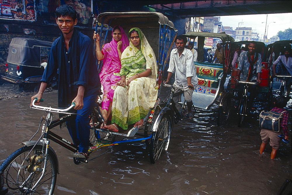 Rickshaw, monsoon, inundation, Varanasi, Benares, Uttar Pradesh, India