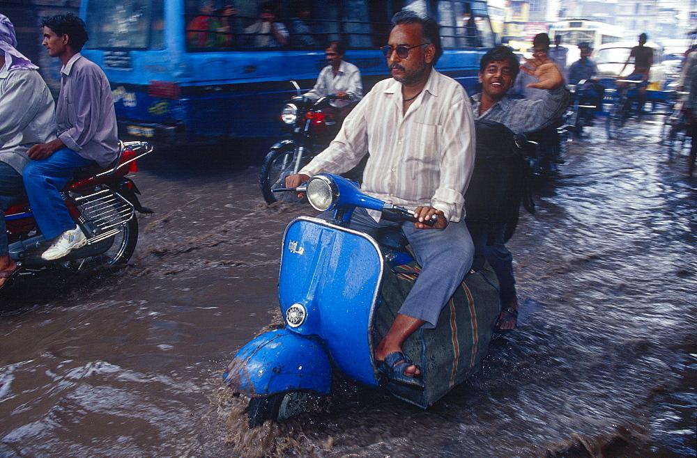Motor scooter, monsoon, inundation, Varanasi, Benares, Uttar Pradesh, India