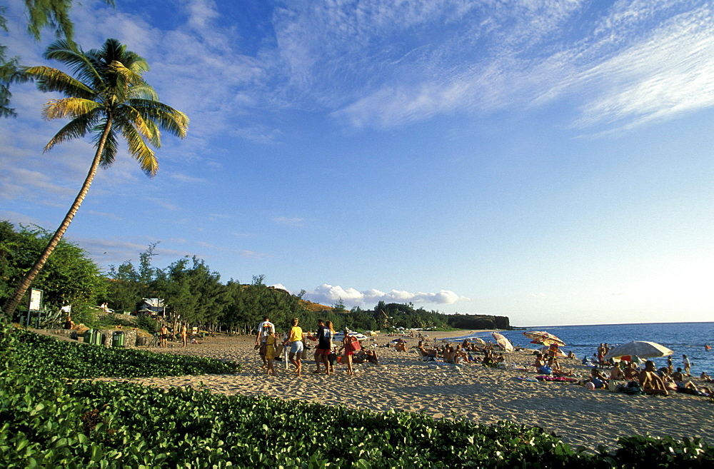 People sunbathing on Boucan Canot beach, La RÈunion, Indian Ocean