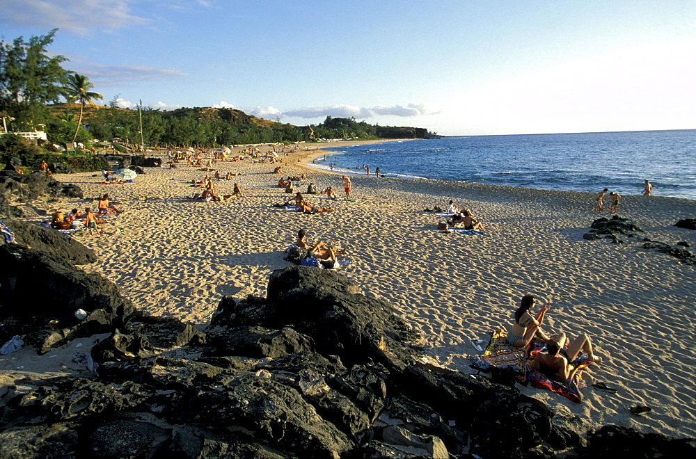 People sunbathing on Boucan Canot beach, La RÈunion, Indian Ocean