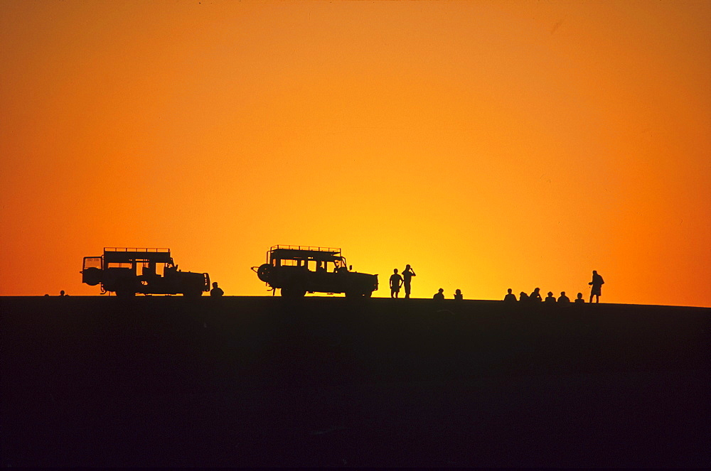 Jeeps and people at sunset, Walvis Bay, Namibia, Africa - 1113-56634