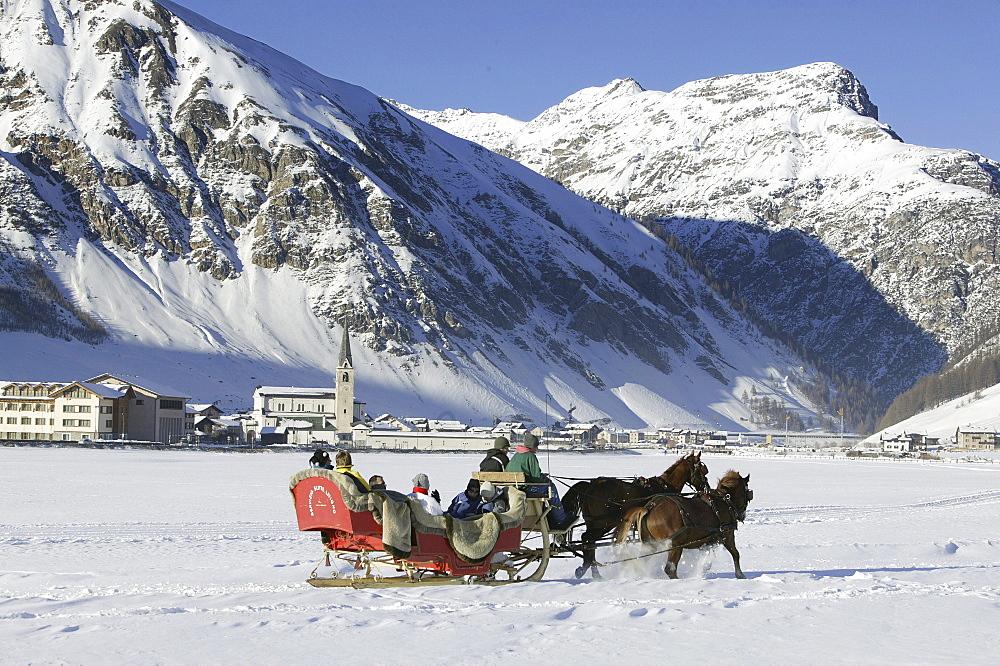 Tourists on a sleigh ride, Livigno, Italy