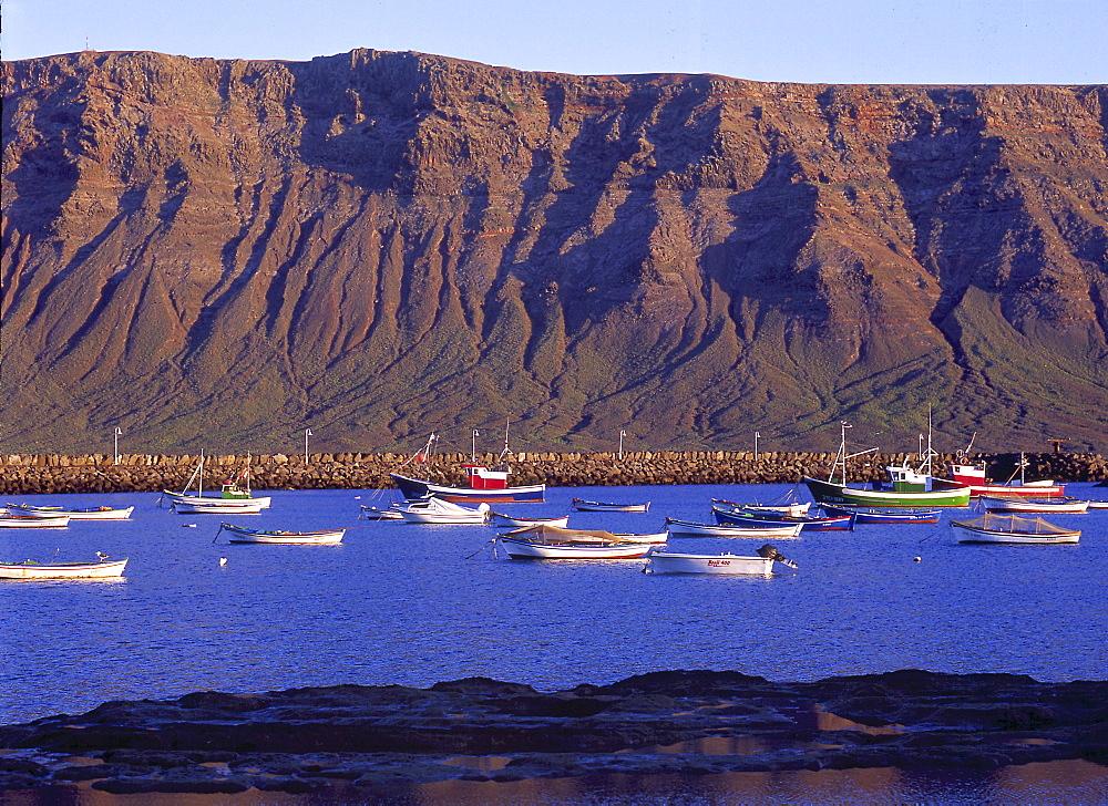 Fishing boats in the harbour, Famara Lanzarote of Caleta del Sebo, La Graciosa, Canary Islands, Spain