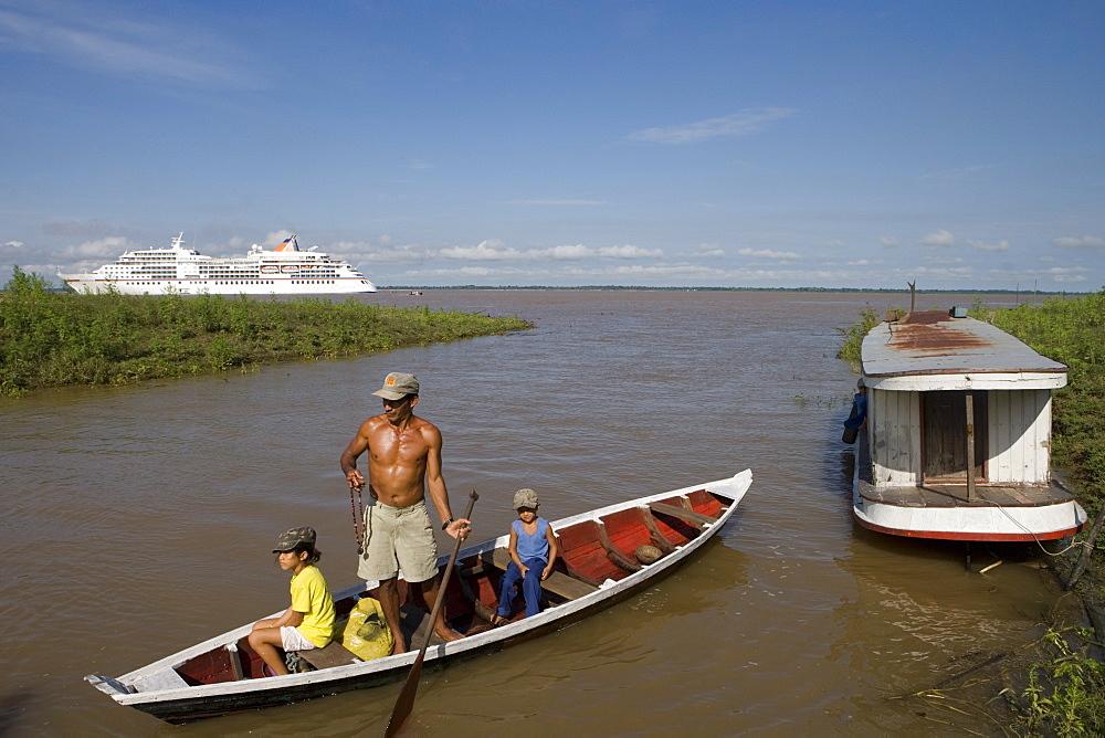 Amazonian Indian Family and MS Europa on a sidearm of the Amazon River, Boca da Valeria, Amazonas, Brazil, South America