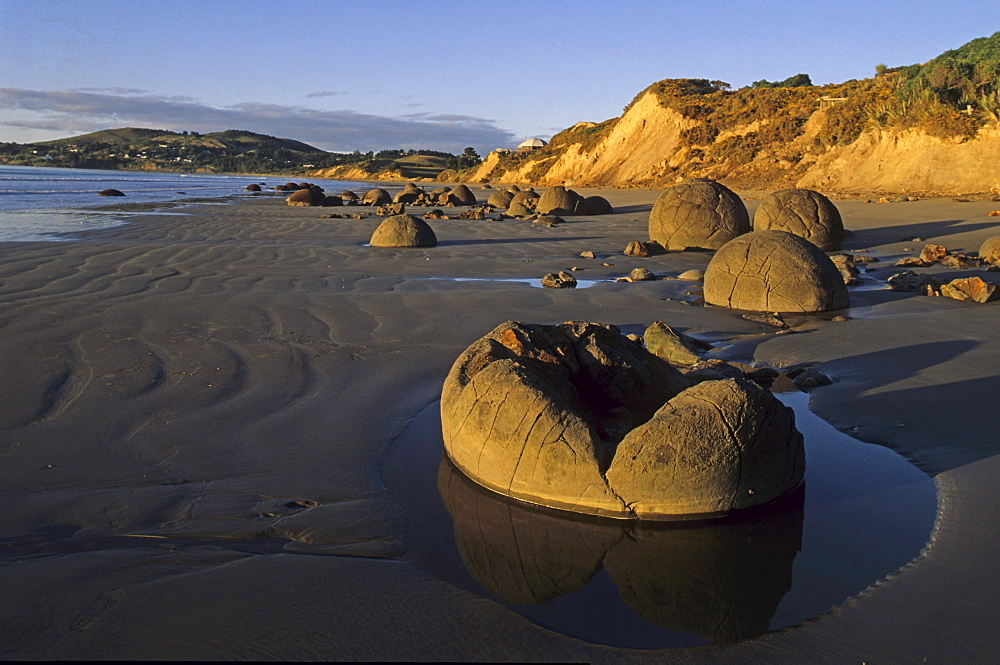Moeraki boulders on the beach in the sunlight, South Island, New Zealand, Oceania