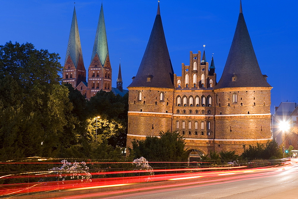 The illuminated Holstentor with St. Mary's church at night, Luebeck, Schleswig Holstein, Germany, Europe