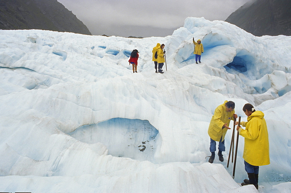 Tourists on Fox Glacier, Westland National Park, South Alps, South Island, New Zealand, Oceania