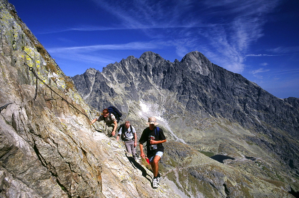 Hikers in front of the Lomnica Peak, High Tatras, Slovakia