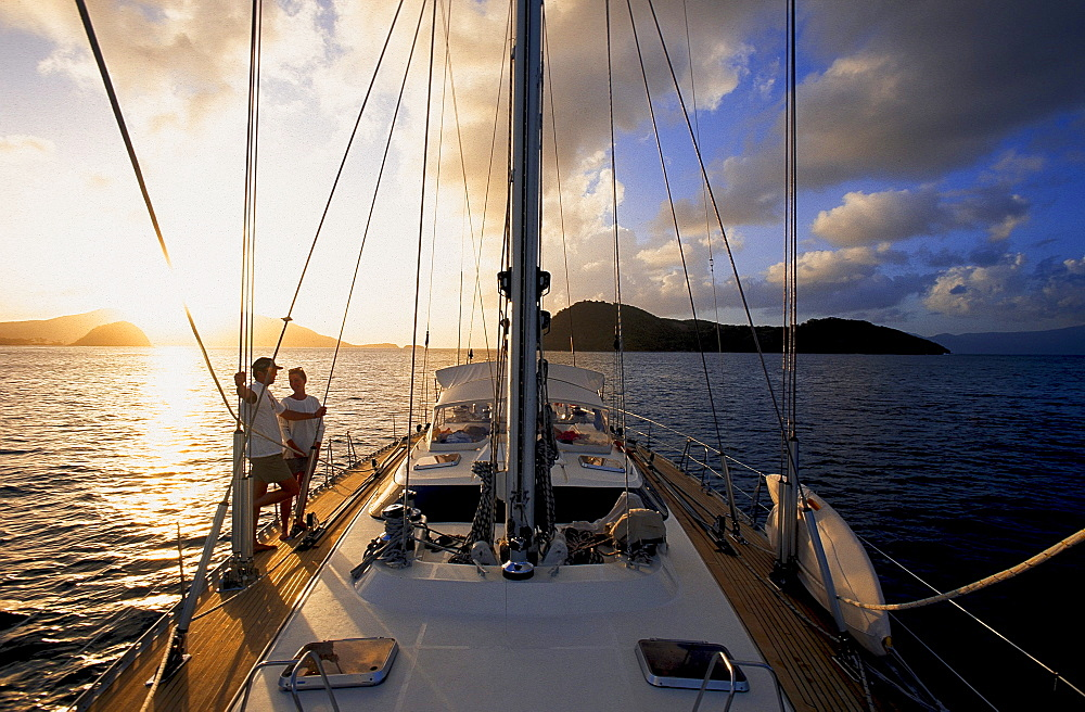 People on a sailing boat at sunset, Iles des Saintes, Guadeloupe Caribbean, America, Caribbean, America
