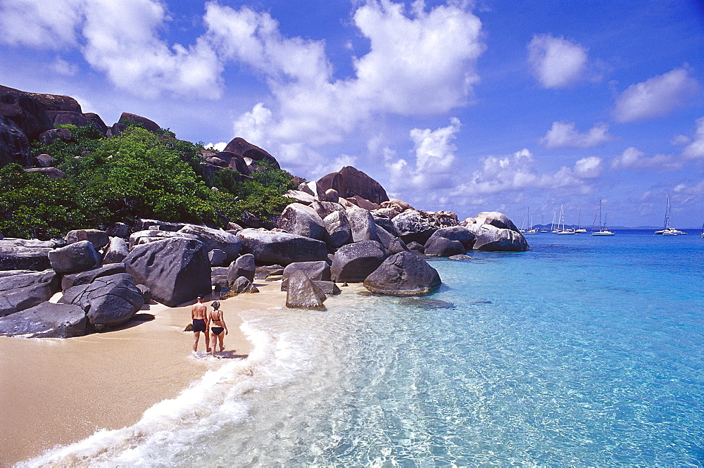 Couple strolling along a beach with rocks, The Baths, Virgin Gorda, British Virgin Islands, Caribbean, America - 1113-60107