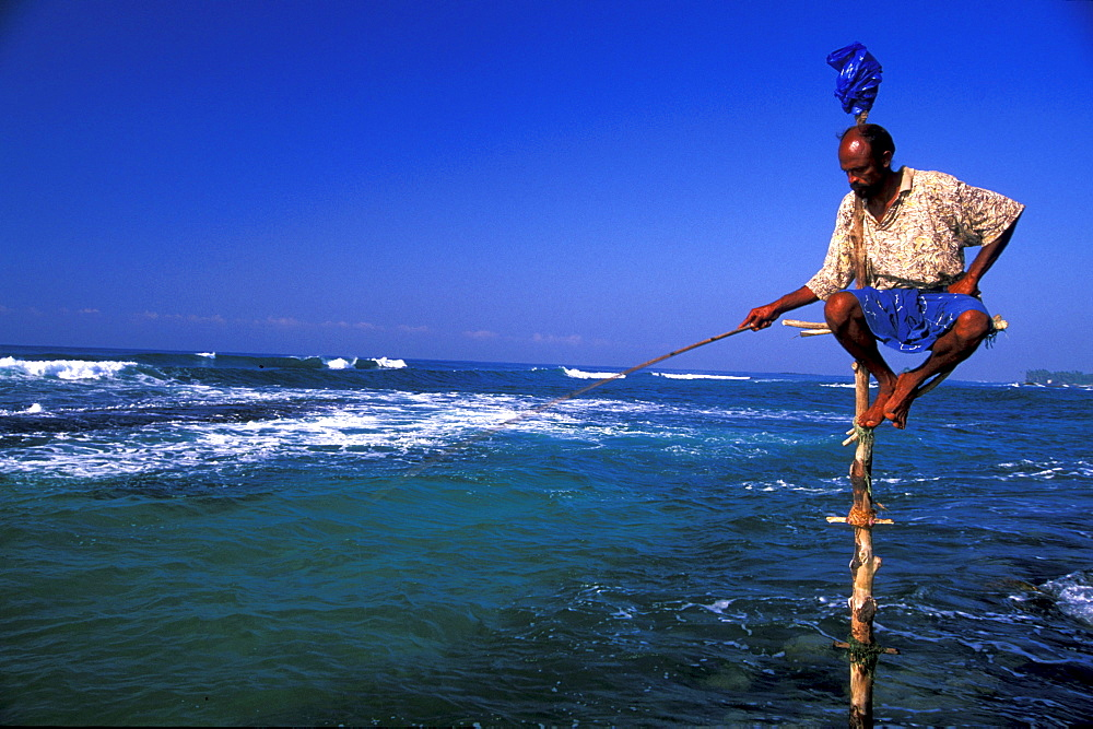 Stilt fisherman with fishing rod, Sri Lanka, Asia
