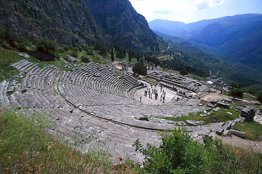 The abcient theatre and Temple of Apollo, Delphi, Peloponnese, Greece