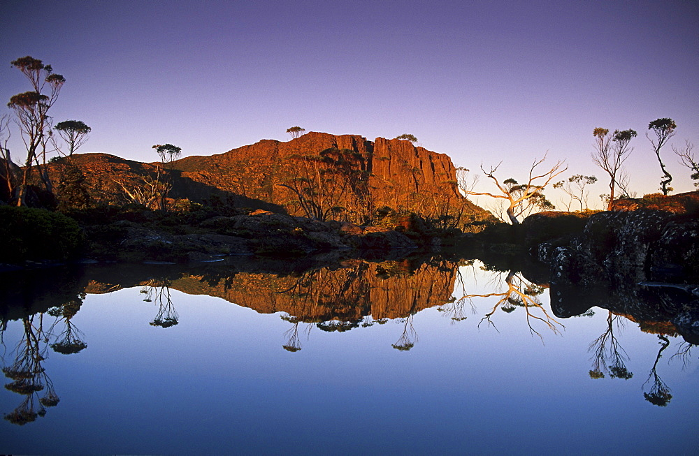 Early morning mirrored reflection of Mount Geryon in Lake Elysia, Overland Track, Cradle Mountain-Lake St Clair National Park, Tasmania, Australia
