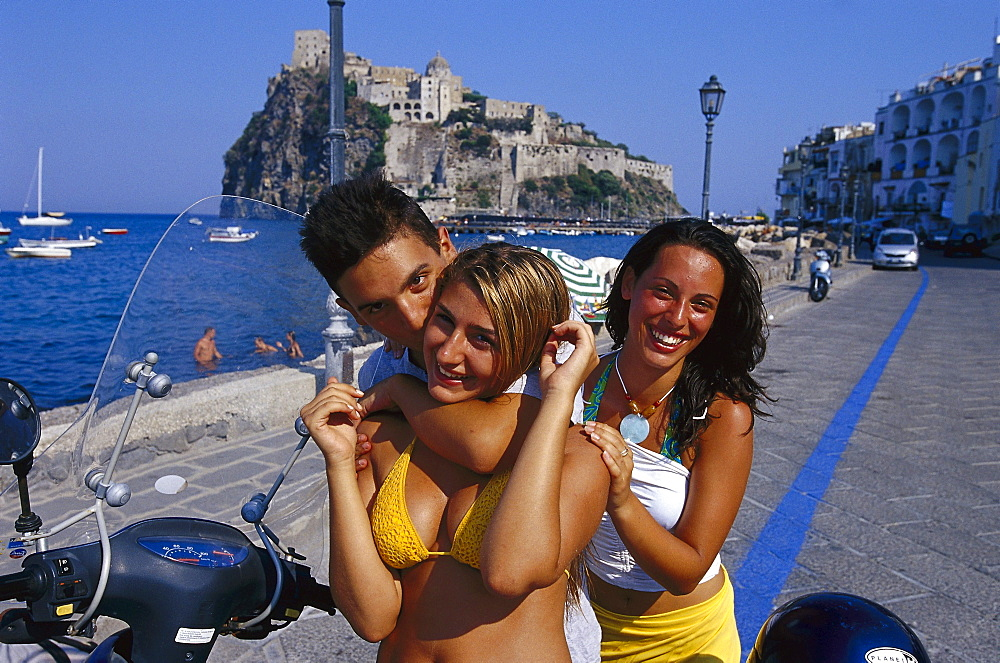 Teenagers in front of the Castello Aragonese, Ischia, Campania, Italy, Europe