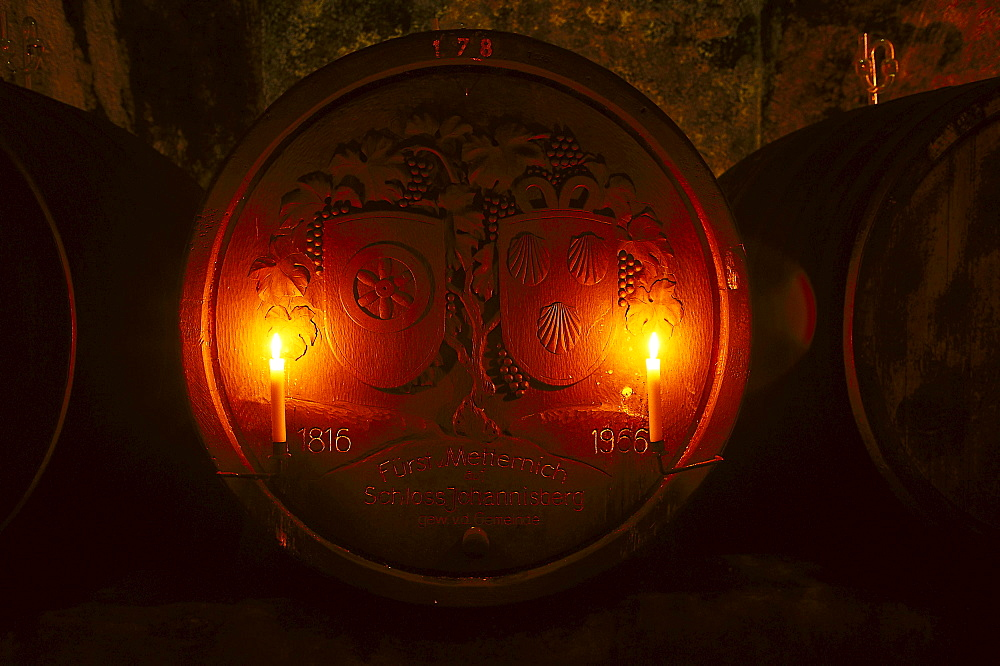 Old candle lit wine barrel at wine cellar of Castle Johannisberg, Rheingau, Hesse, Germany, Europe