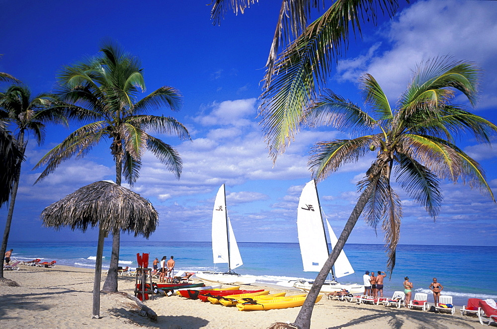 People and sailing boat on the beach, Playas del Este, Cuba, Caribbean, America