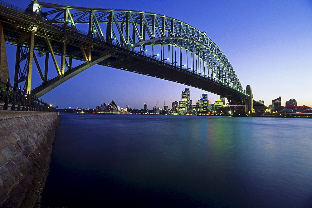 View below the Sydney Harbour Bridge across the harbour to the Opera House, Sydney, Australia