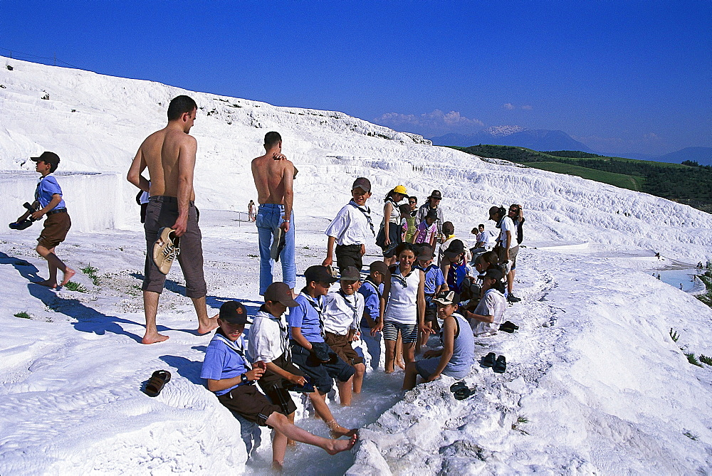 Boy scouts at the limestone sinter terraces, Pamukkale, Denizli, Turkey