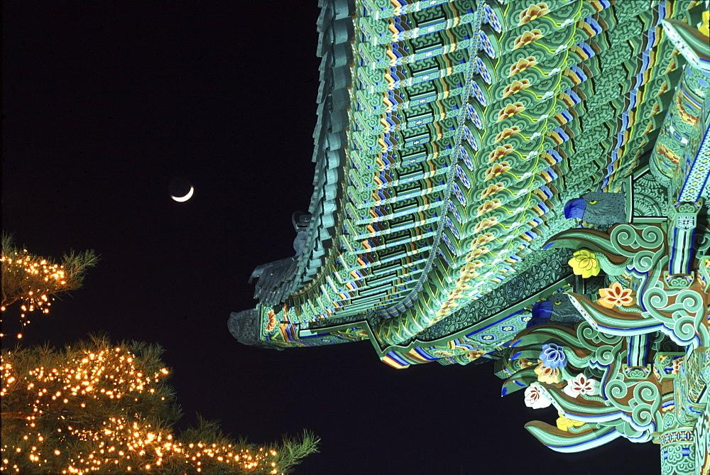 Illuminated temple roof at night, Daegu, South Korea, Asia
