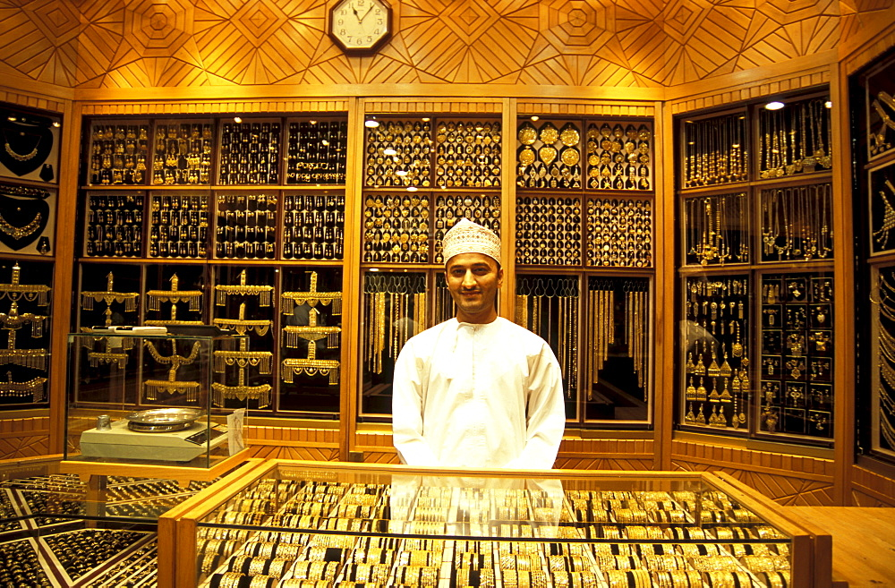 Young salesman in a shop, gold souk, Muscat, Oman, Asia