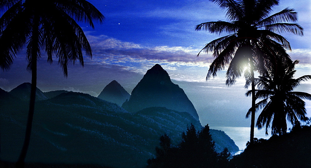 Palm trees and the mountains Two Pitons at moonrise, Soufriere, St. Lucia, Carribean, America
