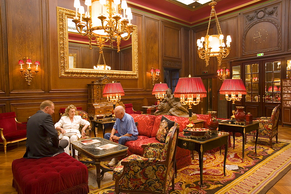 People sitting inside the lobby of Hotel Sacher, Vienna, Austria