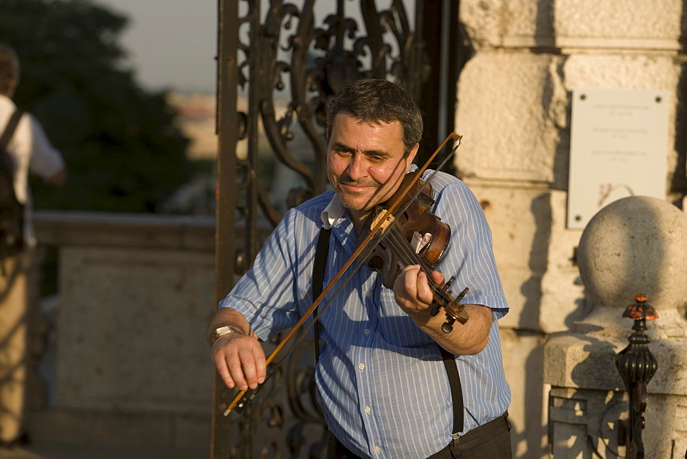 Fiddler at the area of Royal Palace, Fiddler at the area of Royal Palace on Castle Hill, Buda, Budapest, Hungary