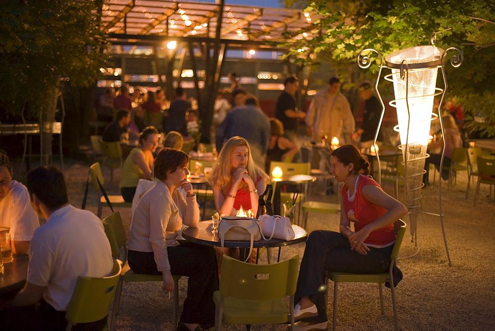 Girls in the open-air nightclub Zoeld Pardon, Young girls sitting in the open-air nightclub Zoeld Pardon, near the Petoefi Bridge, Buda, Budapest, Hungary