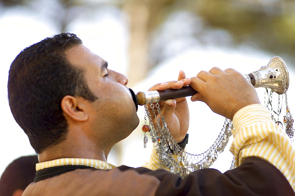 Turkish middle-aged man playing Zurna with silver decorations, Tuerkei
