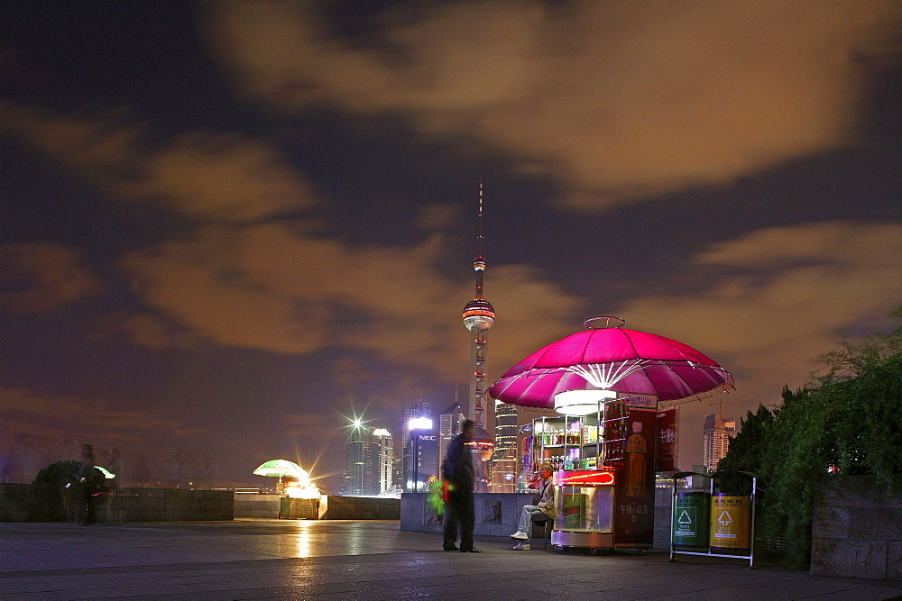 Bund, Huangpu River at night, umbrella covered stand, Shanghai