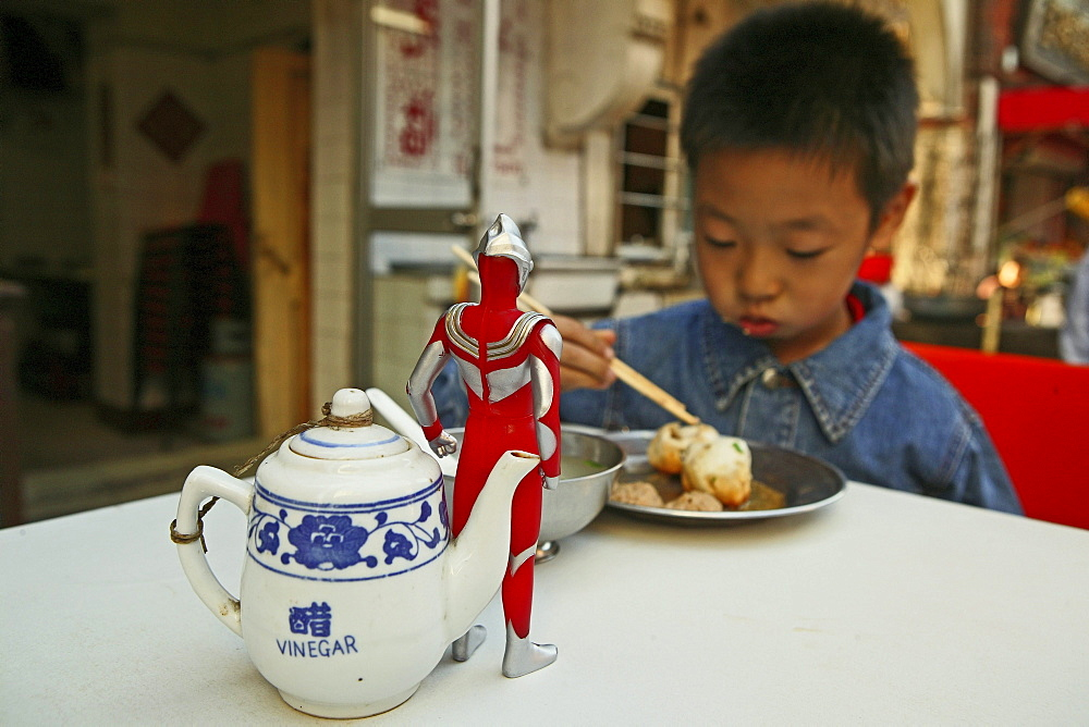 kid, child, young boy Superman toy eating dumpling, biaozi, Little Emperor - 1113-67686