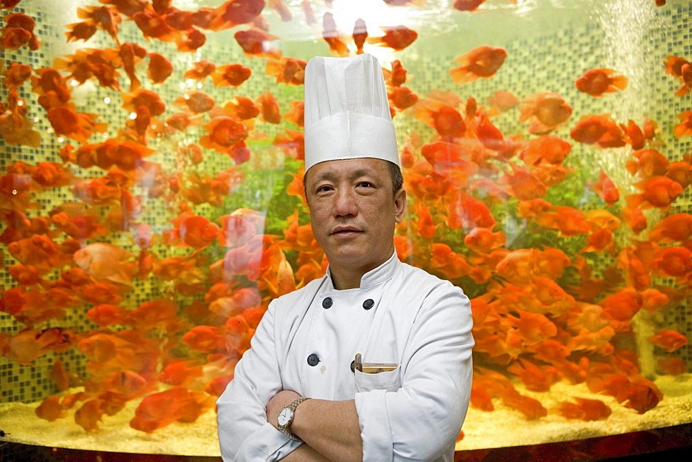 restaurant chef infront of aquarium