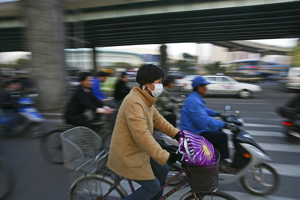 Traffic Shanghai, bicyclist, breathing mask, face-mask, elevated motorway, junction