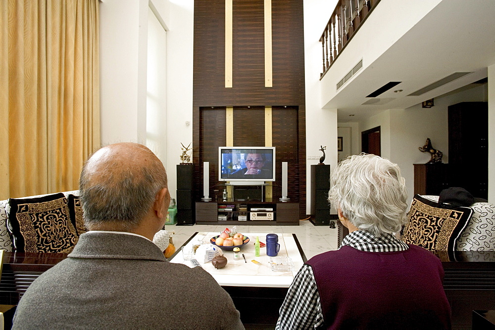 old couple in modern villa, old couple with big TV screen, living room, luxury apartment, western Shanghai, interieur, private house, interior, new suburb