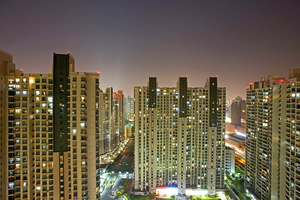 apartment towers, living in Shanghai, highrise apartments, near Souzhou Creek, windows, night