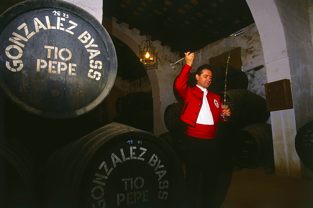 Man in traditional costume filling a glass, Bodegas Gonzales Byass, Sherry, Jerez de la Frontera, Province Cadiz, Andalusia, Spain, Andalusia, Spain, Europe