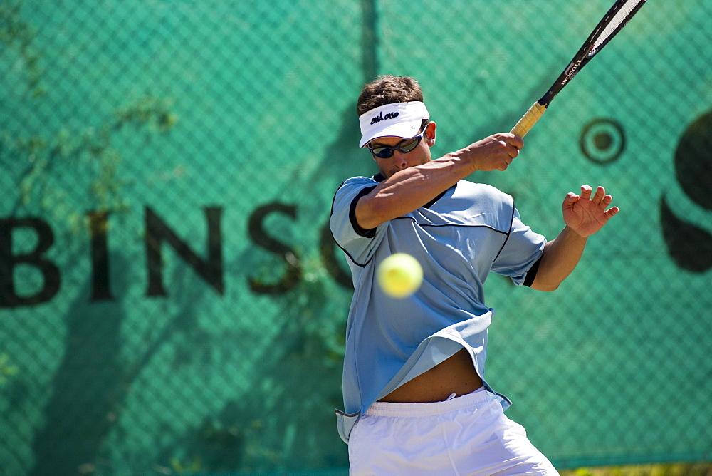 Man playing tennis, Apulia, Italy