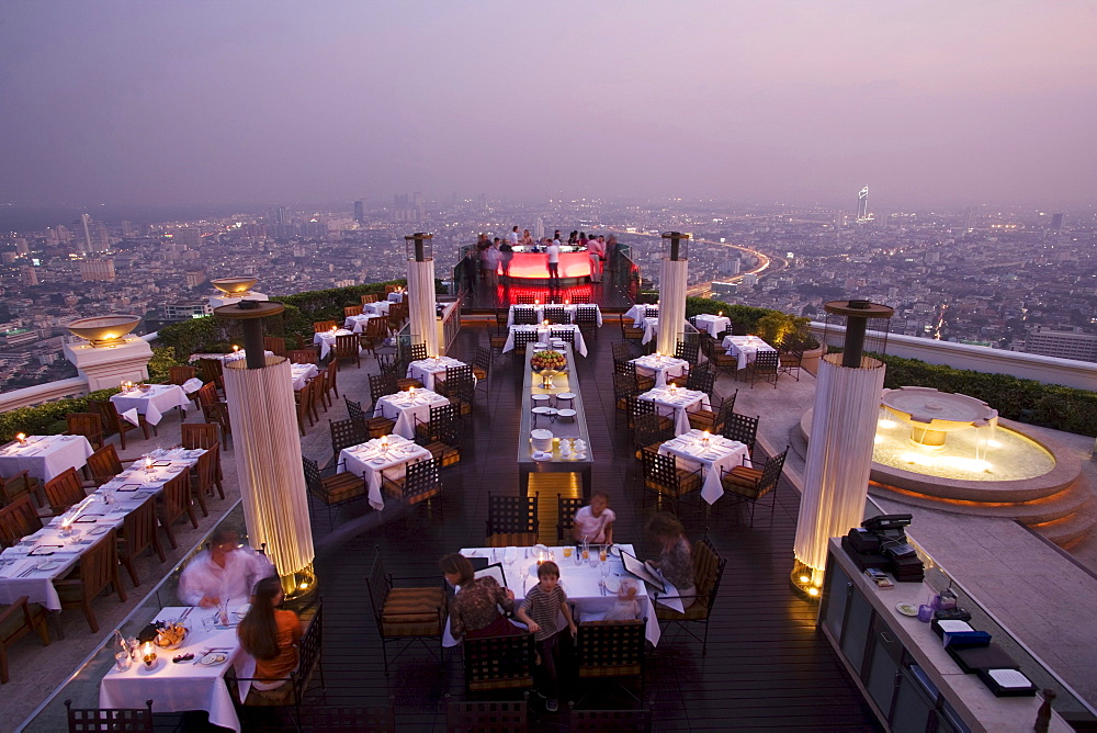 """View over openair-bar """"Sirocco Sky Bar"""" and Bangkok in the evening, State Tower, 247 m, The Dome, Bangkok, Thailand - 1113-70345"""