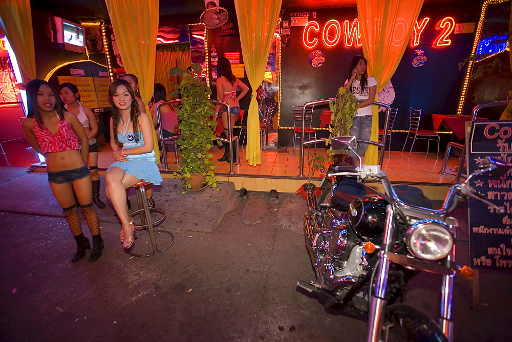 Go-go girls in front of a nightclub, Soi Cowboy, a red-light district, Th Sukhumvit, Bangkok, Thailand