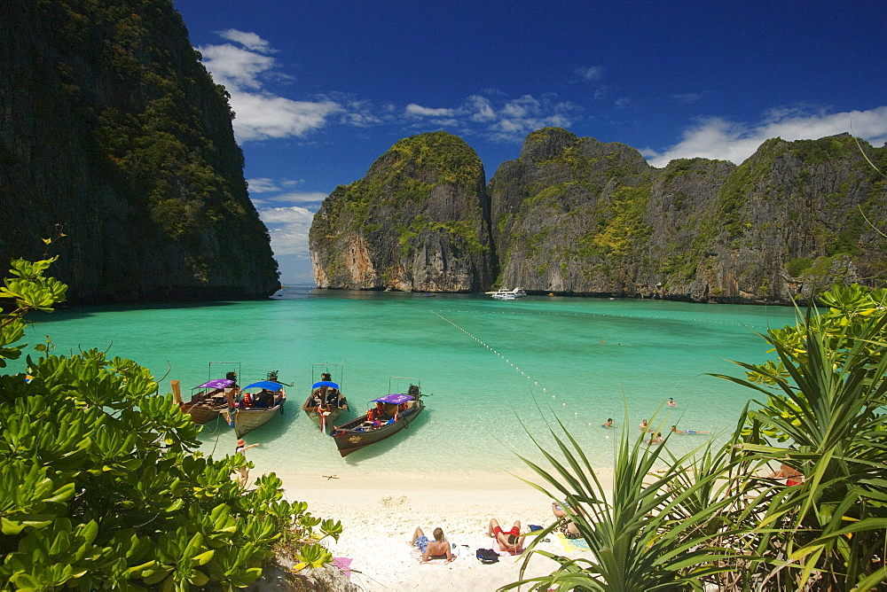 "View over Maya Bay, a beautiful scenic lagoon, famous for the Hollywood film ""The Beach"" with sunbathing tourists and anchored boats, Ko Phi-Phi Leh, Ko Phi-Phi Islands, Krabi, Thailand, after the tsunami"