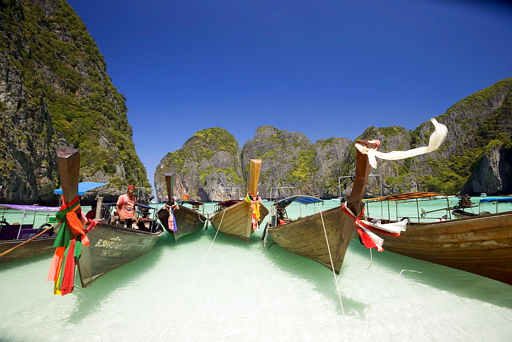 "Boats anchoring in the Maya Bay, a beautiful scenic lagoon, famous for the Hollywood film ""The Beach"", Ko Phi-Phi Leh, Ko Phi-Phi Islands, Krabi, Thailand, after the tsunami"