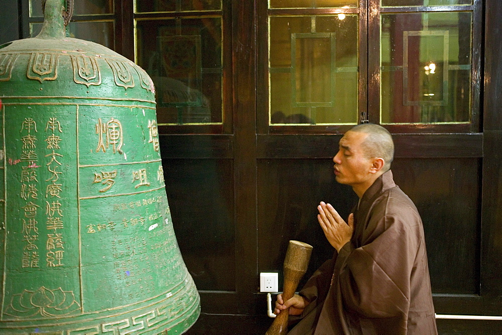 Monk in prayer, meditation, bronze bell, Wannian Monastery and Temple, China - 1113-70985