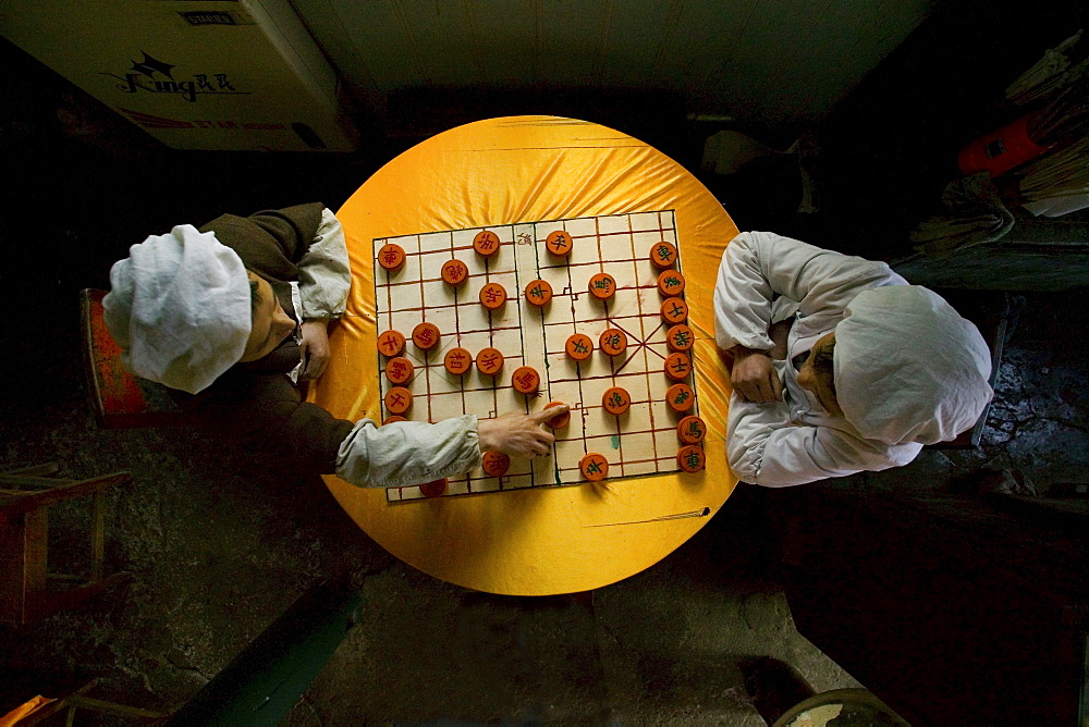 Two cooks playing chinese chess, Emei Shan, Sichuan province, China, Asia - 1113-70995