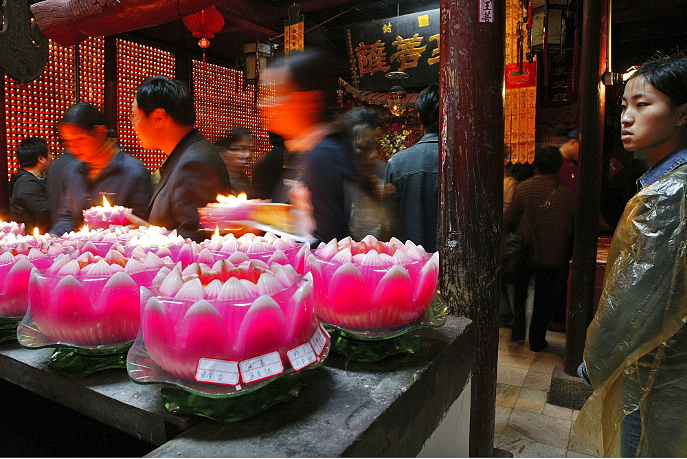 Pilgrims lighting up candles in the form of lotus flowers, Longevity monastery, Jiuhua Shan, Anhui province, China, Asia
