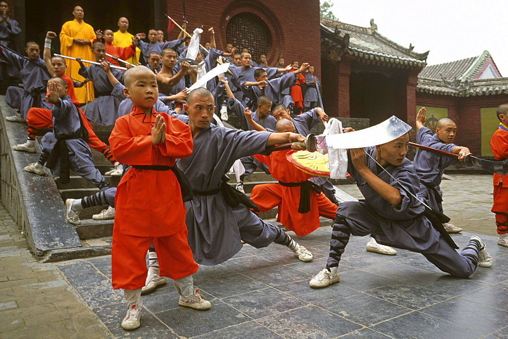 Shaolin Buddhist monks, Kung Fu students rehearsing for a performance on Buddhas birthday, Shaolin Monastery, known for Shaolin boxing, Taoist Buddhist mountain, Song Shan, Henan province, China