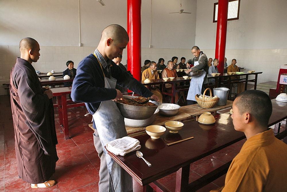 Mealtime and prayer, monastery dining hall, Fawang Monastery, Taoist Buddhist mountain, Song Shan, Henan province, China
