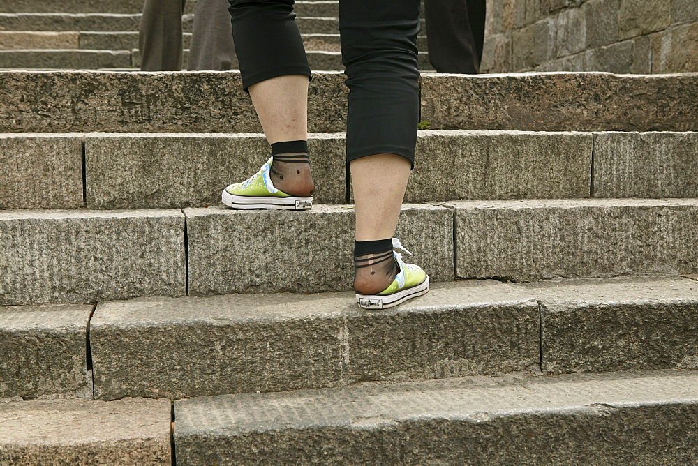 Tourists, pilgrims wearong worn out shoes, Mount Tai, Tai Shan, Shandong province, World Heritage, UNESCO, China